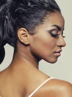 Beautiful profile shot of exotic young woman