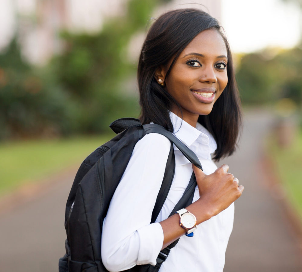 beautiful female college student going to school