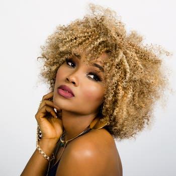 woman-face-curly-hair-157920